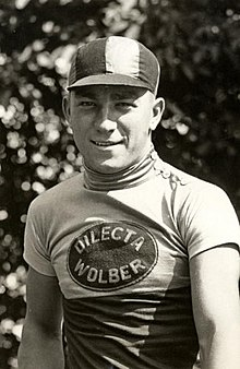 "A man with a cap and a jersey that says ""Dilecta Wolber"""