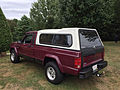 Jeep Comanche 4.0L High Output six 4x4 long-bed burgundy with white cargo cap 1of3.jpg