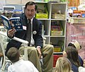 Joe Donnelly reads to students at Wilson Primary Center School in South Bend.jpg