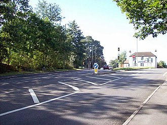 A30 road - The A30 through Bagshot Heath. The former Jolly Farmer pub is in the distance.