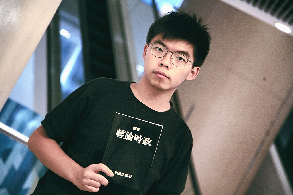 Joshua Wong holds Honcques Laus's book.jpg