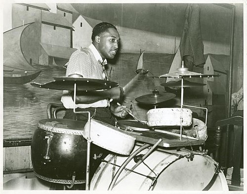 "Drummer in a Memphis ""juke joint"" orchestra playing a kit with four non-tunable toms. Marion Post Wolcott, October 1939 Juke joint drummer.jpg"