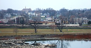 Kaukauna, Wisconsin - Kaukauna's south side downtown, as seen from Statue Park. The Fox River is in the foreground and the Civic Center is on the far right.