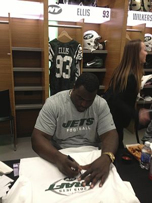 Kenrick Ellis - Ellis signing autographs in the locker room of MetLife Stadium in 2013