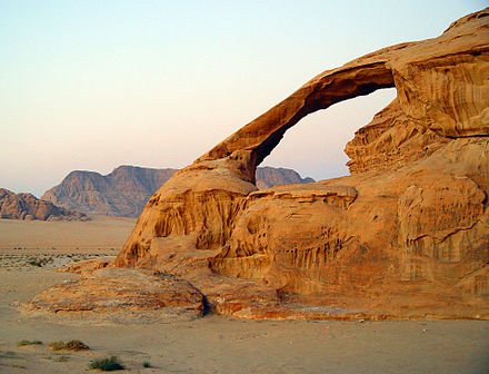 A natural arch produced by the wind erosion of differentially weathered rock in Jebel Kharaz, Jordan KharazaArch.jpg