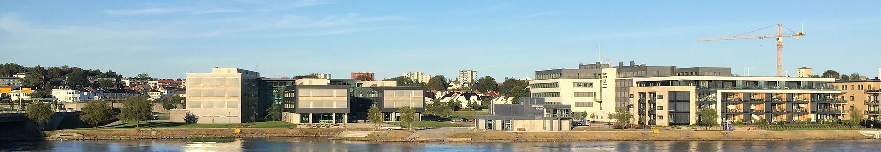 Kjoita Park with Telenor main offices for Southern Norway to the left and Kristiansand Roklubb in the center and apartments to the right Kjoita-panorama.jpg
