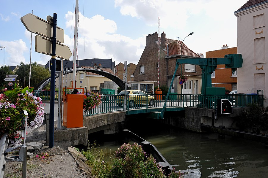 Bascule bridge in Bourbourg over the Canal de Bourbourg; bascule mechanism just on one side; Nord, France.