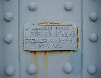 Nameplate - Manufacturer's details on a plate on a bridge in Kraków, Poland