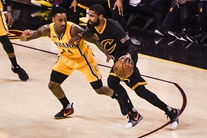 Jeff Teague (basketball) - Teague (left) guarding Kyrie Irving in 2017.