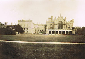 Lambton Castle - The Entrance of Lambton Castle in 1929. Everything on the right hand side of the picture (including the Great Hall, the roof of which can clearly be seen) has been demolished, along with the end of the wing that was built out towards the location of the camera. The crenellated towers on the end of the entrance portico were rebuilt to suit the narrower facade.