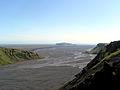 Landskap pa Sydisland. Utsikt till berget Hjorleifshofdi och havet.jpg