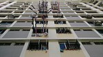 Laundry drying on poles at a Housing and Development Board flat, Singapore - 20140510.jpg