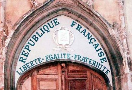 Motto of the French republic on the tympanum of a church in Aups, Var departement, which was installed after the 1905 law on the Separation of the State and the Church. Such inscriptions on a church are very rare; this one was restored during the 1989 bicentennial of the French Revolution. Liberte-egalite-fraternite-tympanum-church-saint-pancrace-aups-var.jpg