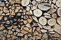 Log pile at The Plough in Lower Beeding, West Sussex, England.jpg