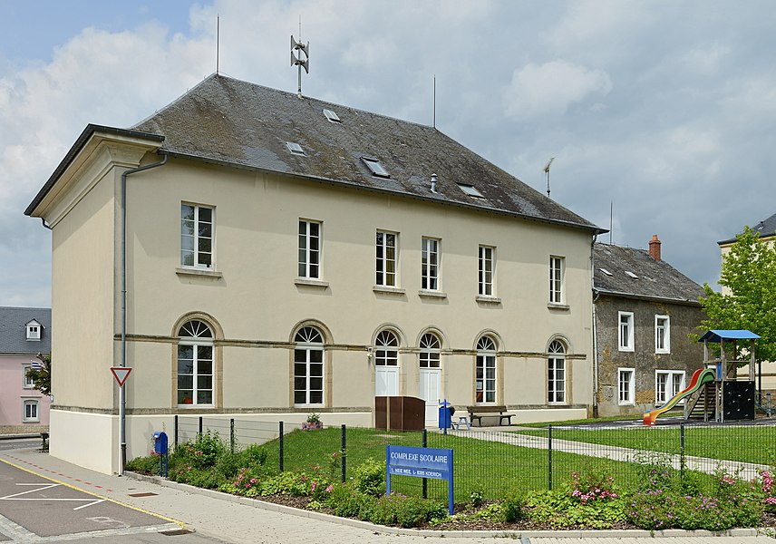 School building in Koerich, Luxembourg. At the right: the house inhabited by Michel Rodange from 1862 to 1966.