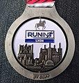 Médaille semi-marathon Run in Lyon 2019.jpg