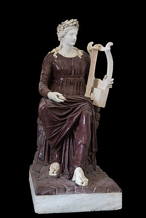Farnese collection - Apollo seated with lyre. Porphyry and marble, 2nd century AD. Farnese collection, Naples, Italy.