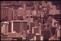 MASSED HIGHRISES OF WAIKIKI DISTRICT, FAVORITE OF TOURISTS SEEN FROM TOP OF DIAMOND HEAD, THE FAMOUS EXTINCT VOLCANO.... - NARA - 553674.tif