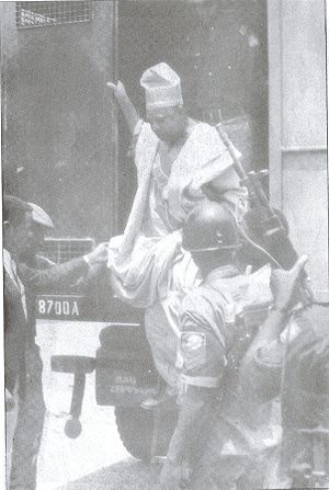 Moshood Abiola - Moshood Abiola leaving a Black Maria van under heavy armed guard