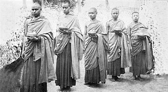 Buddhist monks from Nepal. According to the earliest sources, the Buddha looked like a typical shaved man from northeast India. Mahapragya exiled 1926 wk.jpg