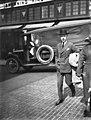 Man crossing downtown street, Seattle, ca 1917-ca 1920 (SEATTLE 4543).jpg