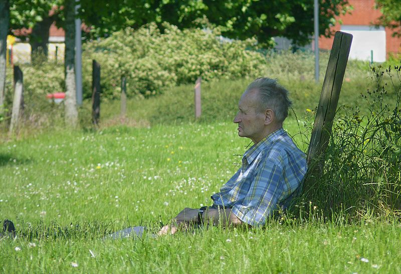File:Man sitting in the shade J1.jpg