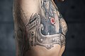 Man with armpit tattoo. Razor Neva, blood type, birth year. Color.jpg