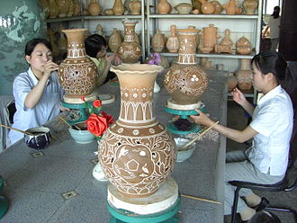 Mansudae Art Studio - Artists working on ceramics at Mansudae Art Studio