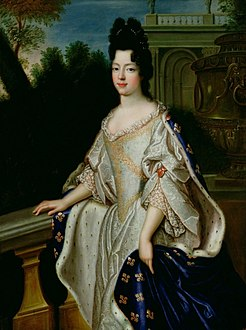 Marie Adélaïde of Savoy as depicted circa 1697 (wearing Fleur-de-lis as Duchess of Burgundy) by a member of the École Française.jpg
