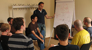 Canonical (company) - Mark Shuttleworth (standing) and other Canonical employees discuss Launchpad at a design sprint in Germany
