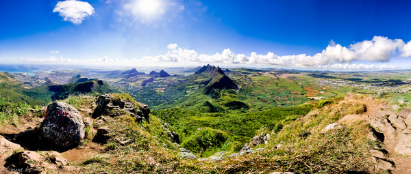 Panoramic view showing Port Louis, mountain ranges, and sugar cane plantations