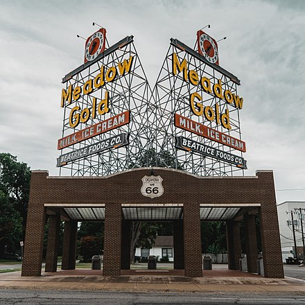 The Meadow Gold sign has greeted Route 66 travelers in Tulsa for decades. Meadow Gold Neon Sign Route 66 Tulsa Oklahoma.jpg