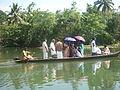 Men in boat akkarappadom.JPG
