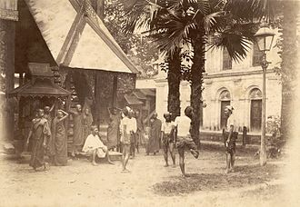 Chinlone - One of the first photographs of men playing chinlone, taken around 1899