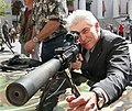 Michael Grant sights in an Army sniper rifle as he checked out weaponry on display in the Capitol courtyard during Florida National Guard Day.jpg
