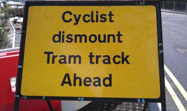 Midland Metro - Cyclist dismount sign - Andy Mabbett