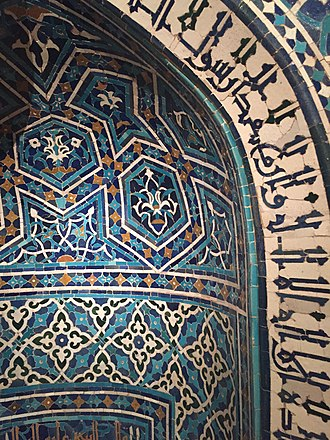 Kufic - A close up to the Arabic inscription on the frame of the Mihrab in Kufic script from Madrasa Imami originally located in Iran (1354-55).