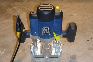 Router (woodworking) - Modern plunge router showing dust extraction tube