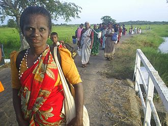 Kataragama temple - People of Coast Vedda descent taking a pilgrimage on foot (Pada Yatra) from the town of Muttur in the east of Sri Lanka to the temple