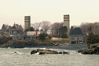 Fire control tower - Two typical fire control towers on Swallow Cave Rd. in Nahant, Massachusetts, known during WW2 as Site 131. Site 131-1A is on the right in this photo. Built in 1943-44, these twin towers watched over the northern approaches to Boston Harbor and directed the guns of several different Coast Artillery batteries. Towers similar to these can be found today in all coastal New England states.