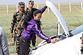 Nepalese Army Cpl. Dipak Bohara, with the Birendra Peace Operation Training Center, searches a role player's vehicle at the vehicle checkpoint training lane during Khaan Quest 2013 at Five Hills Training 130807-M-DR618-072.jpg