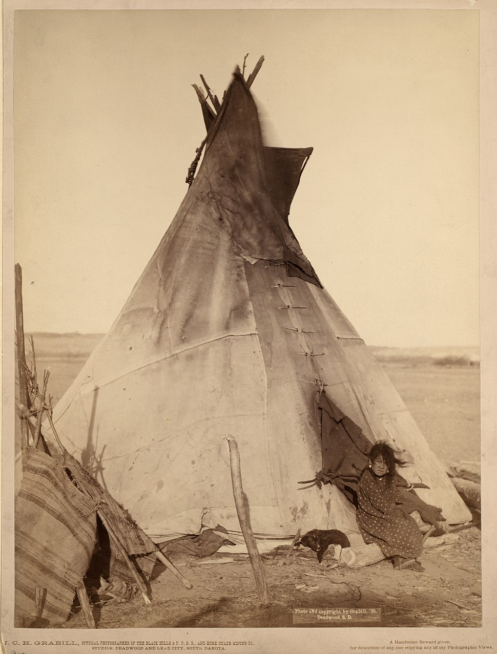 Oglala girl in front of a tipi