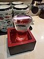Overflowing sake glass in masu.jpg