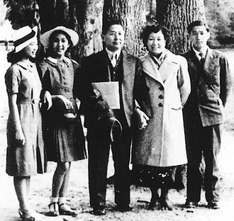 Sun Fo -  Sun Fo (center) with his family during a diplomatic mission in France in 1938. Pictured from left to right are daughters Sun Sui-ying and Sun Sui-hwa, Sun Fo, his wife Chen Suk-ying, and younger son Sun Tse-kiong. Eldest son, Sun Tse-ping, not pictured, was then living and working in the U.S.A.