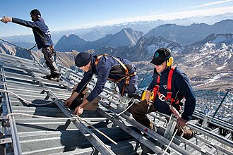 Blue-collar worker - Workers constructing a photovoltaic system.