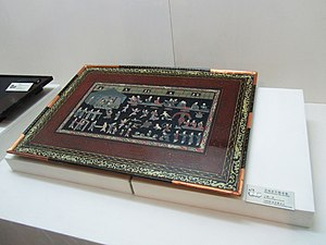 Zhu Ran - Painted lacquerware table from the tomb of Zhu Ran (182-249) in Anhui province, Eastern Wu period, showing figures wearing silk Hanfu attire