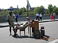 Paris, France. Musicians in the street, repose before to play for the public.jpg