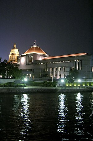 Parliament of Singapore - Parliament House by the Singapore River with the dome of the Old Supreme Court Building in the background, photographed on 7 September 2006