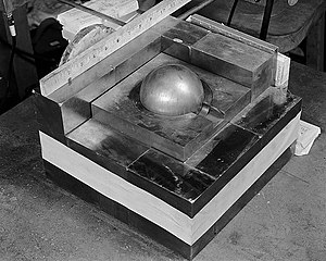 Demon core - A re-creation of the experiment involved in the 1945 incident. The sphere of plutonium is surrounded by neutron-reflecting tungsten carbide blocks.