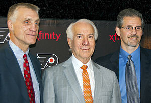 Paul Holmgren - Paul Holmgren, Ed Snider and Ron Hextall on May 7, 2014, as Holmgren became President and Hextall was made GM of the club.